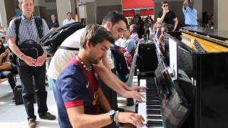 Passer By Joins a Guy Playing the Piano