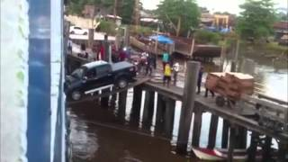 Car boarding a ship over a plank