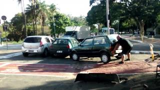 Cyclist Lifts Car Off Bike Path
